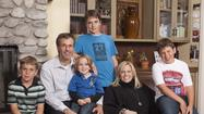 Scott Niedermayer with his family at the Ronald McDonald House of Orange County. At left is Joshua. Luke is on Scott's lap. To the right of Lisa is Jackson. Logan is at top.