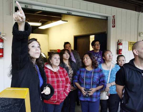 Burbank Police Officer Cindy Guillen directs a tour of the Burbank Police Department shooting range in Wildwood Park in Burbank. Police hosted a community academy for Latino residents to show them how the department works and makes life-or-death decisions.