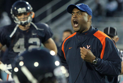 UVA head coach Mike London gets the team fired up during a spring practice Friday at Christopher Newport University.