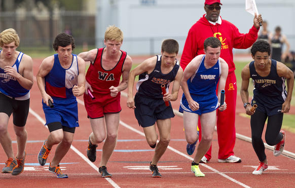 Runners take off from the starting line during the first leg of the 4x800 meter relay at the Conn-Madden Relays at Todd Stadium on Saturday.