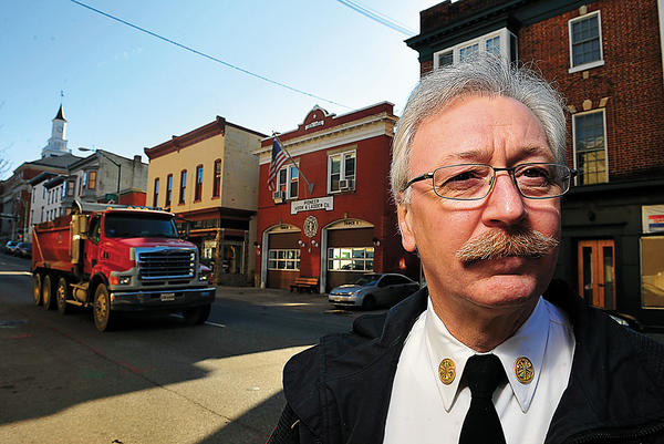 Kyd Dieterich is chief of Hagerstown Fire Department. He volunteered in the 1970s at Pioneer Hook and Ladder fire company, seen behind his right shoulder.