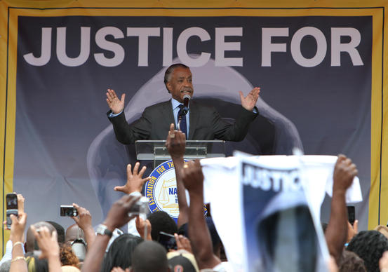 The Rev. Al Sharpton speaks during a NAACP rally and march demanding for justice in the shooting of Trayvon Martin outside the Sanford Police Department in Sanford, Fla. Saturday, March 31, 2012.