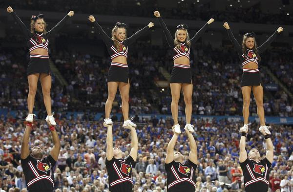 Louisville Cardinals cheerleaders perform at the men's NCAA Final Four semi-final college basketball game in New Orleans, Louisiana, March 31, 2012. REUTERS/Jeff Haynes