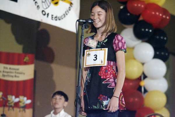 Palm Crest Elementary School's Solenn Matuska spells out a word during the Seventh Annual Los Angeles County Elementary Spelling Bee contest, which took place at the Almansor Court Conference Center in Alhambra. Matuska won the spelling bee contest.