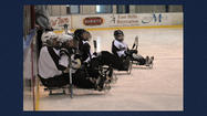 PHOTOS: See photos of Sitting Bulls sled hockey team