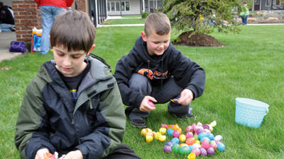 Austin Heitzer, 9, and Tanner Shaulis, 8, divy up their winnings Saturday after the annual Easter Egg Hunt on the courtyard lawn of the Georgian Place in Somerset. Heitzer and Shaulis, both of Somerset, were among the children racing to collect more than 6,000 eggs filled with candy and prizes. The event was sponsored by the Somerset Area Jaycees and the Georgian Place.