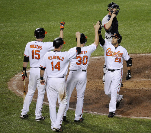 The Orioles trailed the Red Sox 10-1 heading into the bottom of the seventh. But they scored five runs in the seventh, which included a three-run, pinch-hit homer by Oscar Salazar (above right). They then scored five more in an eighth inning that included pitcher Jeremy Guthrie's entering as a pinch-runner and scoring the tying run on a two-run double by Nick Markakis against closer Jonathan Papelbon. It was the largest comeback in Orioles history at Camden Yards.