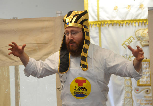 Rabbi Eli Strasberg, of Media, summarizes the story of Passover, at the start of a model matzoh bakery at Chabad of the Lehigh Valley in South Whitehall Township on Sunday, April 1, 2012.  Matzoh which is an unleavened bread, is eaten by Jews  during the Passover Seder meal as well as the the 7 or 8 days of Passover. During Passover, eating bread and foods made with leavened grain¿is forbidden according to Jewish law.  Passover, which begins at sundown Friday, April 6, commemorates the story of the Exodus, when the ancient Israelites were freed from slavery in Egypt. It is one of the most widely observed Jewish holidays. In the narrative of the Exodus, God helped the children of Israel escape slavery in Egypt by inflicting ten plagues upon the Egyptians before the Pharaoh (Egyptian ruler) released the Israelite slaves. When the Pharaoh freed the Israelites,  they left in such a hurry that they could not wait for bread dough to rise (leaven). In commemoration, for the duration of Passover no leavened bread is eaten, for which reason it is called The Festival of Matzoh or unleavened bread.