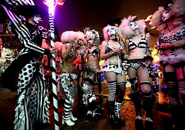 "Rave performers wait in the wings before taking the stage with ""Laidback Luke"" June 22 at the L.A. Coliseum during the massive Electric Daisy Carnival rave at Exposition Park and LA Coliseum."