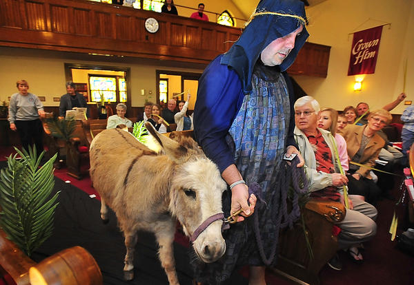 Mike Martin leads Caroline into Washington Square United Methodist Church sanctuary Sunday at the start of Palm Sunday service.