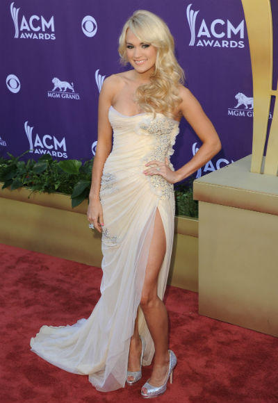 Academy of Country Music Awards 2012 Best & Worst: Taylor Swift, Carrie Underwood, Blake Shelton and more: Angelina Jolie created a sensation at the Oscars without saying a word. All she did was work her Angelina magic by thrusting one long leg out of her dress. A meme was instantly born. And a couple of months later, Carrie Underwood gave it her all on the ACM purple carpet. Cute, but too late.   --Liz Kelly Nelson, Zap2it