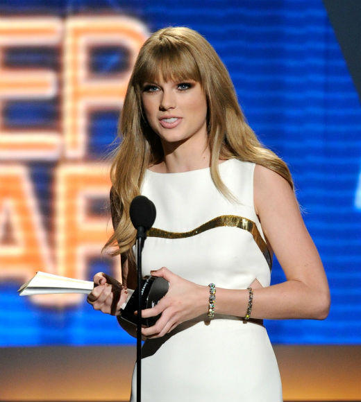 Academy of Country Music Awards 2012 Best & Worst: Taylor Swift, Carrie Underwood, Blake Shelton and more: Taylor Swift was supposed to take New Jersey teen Kevin McGuire, who is suffering from leukemia, as her date the the awards, but since McGuire was rushed to the hospital with a high fever at the last minute, she promised him a shoutout on the program at the very least. In Swiftys acceptance speech for Entertainment of the Year -- her second in a row, by the way -- she acknowledged McGuire, saying, Kevin and all your family and your friends, thank you for wanting to take me to the ACMs. How sweet. Swift tweeted on Saturday that she hoped to make it up for McGuire soon, so hopefully she has something fun up her sleeve for her dedicated fan. -- Jean Bentley, Zap2it