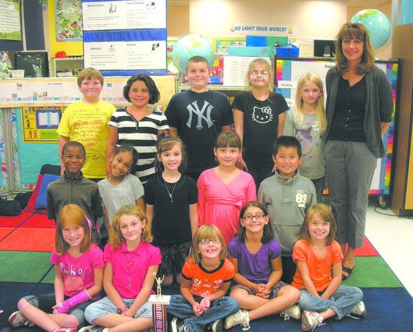 Hickory Elementary School students collected bags of candy to be sent overseas to U.S. troops. Karen Coxs third-grade class won first place. First row from left, Kaitlyn Hoover, Isabella Wegman, Mariah Naugle, Emilee Shoop and Jordan Rohrer. Second row, Diamante Caldwell, Karina Canela, Kaiden Echeverry, Haley Bui and Eric Wang. Third row, Will Quebedeaux, Hayleigh Burgey, Spencer Lane, Tea Talor, Athena Pike and Cox. Absent from the picture is Mary Frances Troast.