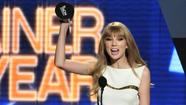"<span style=""font-size: small;"">Taylor Swift took home the ACM's most coveted honor of the night – Entertainer of the Year. She knows the award was voted on by fans and she can't wait to thank them with new music this year. ""You know, for me I'm always looking forward, and I'm always ahead at what's next – and I'm writing my next record right now, as I have been for the last two years, but intensely writing my next record right now. I hope it's good, keep your fingers crossed I would love it if it was good!"" This is Taylor's second consecutive win as ACM Entertainer of the Year.</span>"