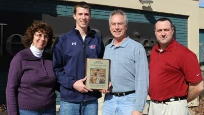 Pellston High School senior Christopher Hass (second from left) stands with his parents, Jeannette (left) and Cliff (second from right) and News-Review sports editor Andy Sneddon after being named the 2011-12 News-Review boys basketball player of the year.