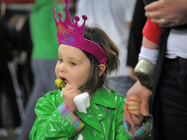 Carolina Borth, 4, gnaws on a pickle-on-a-stick at the 2012 season grand opening of the Baltimore Farmers' Market.