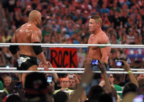 The Rock, left, takes on John Cena at WrestleMania.