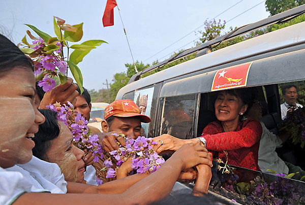 Myanmar opposition leader Aung San Suu Kyi greets supporters as she travels across her constituency in Kawhmu. The elections seen as a test of the government's budding reforms, with opposition leader Aung San Suu Kyi standing for a seat in parliament for the first time.