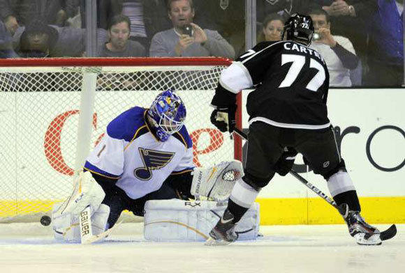Jeff Carter scores on St. Louis Blues goalie Brian Elliott during an overtime shootout on March 22.
