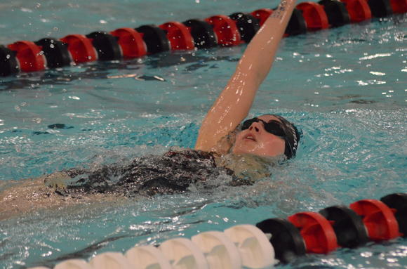 Great Bend senior Tasha Davis swims in the 100 Backstroke Monday in Great Bend.