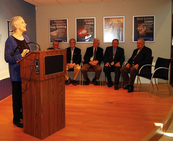 Patriot Federal Credit Union Chief Executive Officer Peggy J. Bosma-LaMascus speaks Monday when presenting $25,000 on behalf of the bank to a veterans' memorial in Chambersburg, Pa.