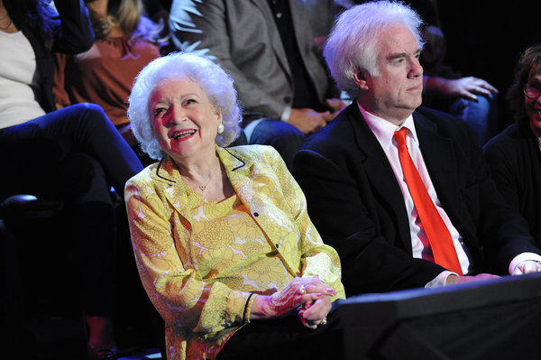 "She's not competing, but Betty White graced ""The Voice"" with her presence."