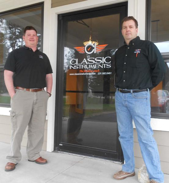 Classic Instruments general manager Ron Hanna (left) and owner John McLeod stand outside the office space newly renovated for their companys use in Boyne Citys industrial park.