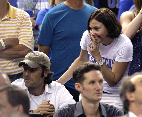 Actress and Kentucky superfan Ashley Judd reacts Monday as she stands next to her husband, two-time Indianapolis 500 winner Dario Franchitti during the second half of the NCAA championship Monday.