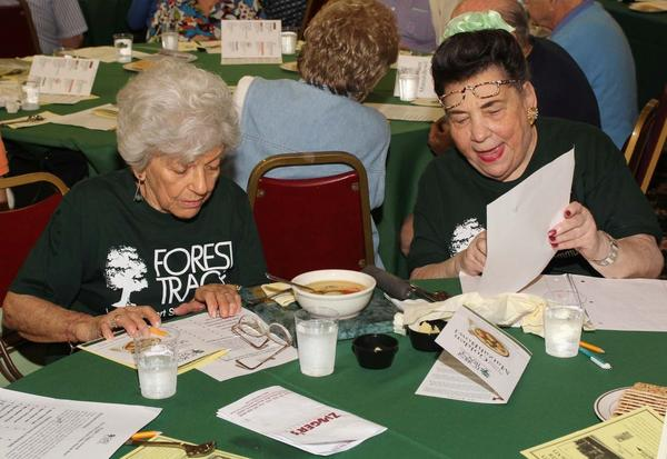 "Karla Goldstein, left, and Peggy Lesker vote for their favorite matzah ball during the third annual ""Golden Matzah Bowl,"" which was hosted by Forest Trace, a retirement community located in Lauderhill. Participation in the contest was free, though all attendees were asked to donate a box of matzah ball mix to WECARE, the Broward food pantry."