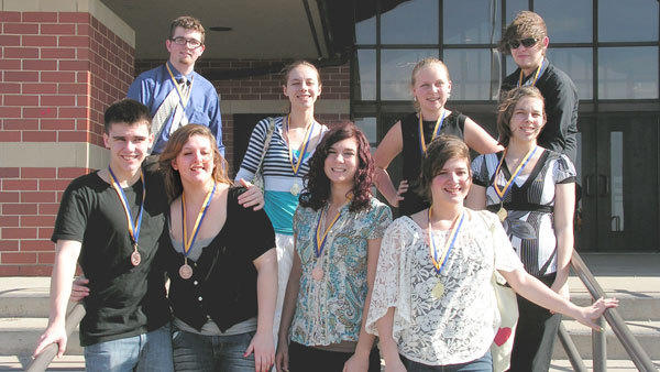 Gaylord forensics team members (front, l-r) Parker Paxson, Rachale LaCross, Annie Jacobites, Bri Hrejsa, Katelynn Thornton; (back, l-r) Josh Nivison, Allison Thornton, Allison Cavanaugh and Nic Cummins display the medals won at Gaylord's annual tournament.