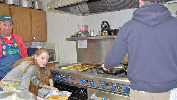 The first time the Otsego County Community Foundation came to the rescue of the Gaylord Area Community Meal program was with a $2,000 grant to buy the commercial stove being utilized by Joe Wambold and Madalyn Lefler to prepare last Friday's community meal.