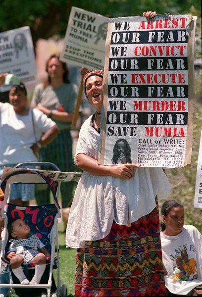 Suezy Johnson protests during a 1990s demonstration in support of Mumia Abu-Jamal.