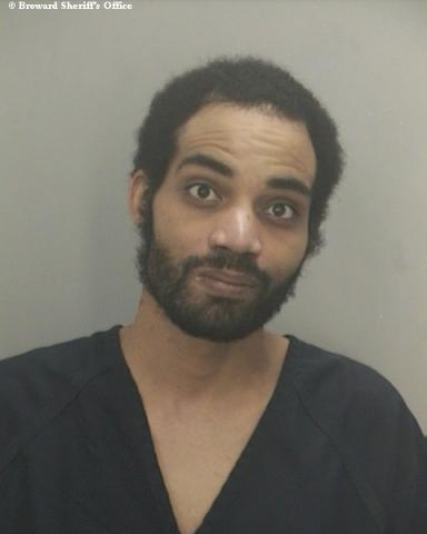 Terrel Rey was arrested for displaying a police badge tag on his Nissan.