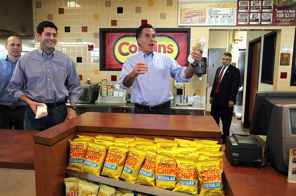U.S. Rep. Paul D. Ryan (R-Wis.), left, and Republican presidential candidate Mitt Romney hand out sandwiches to supporters at Cousins Subs in Waukesha, Wis.