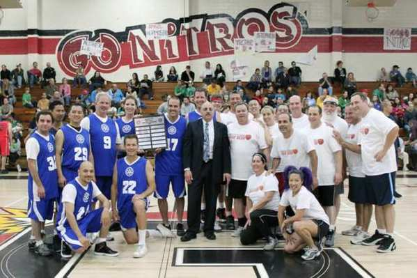 Team Rotary and Team Kiwanis at the charity basketball game on Sunday at Glendale High School.