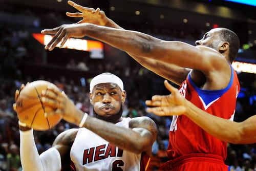 Miami's LeBron James goes hard to the basket as Philadelphia's Elton Brand comes in on defense.