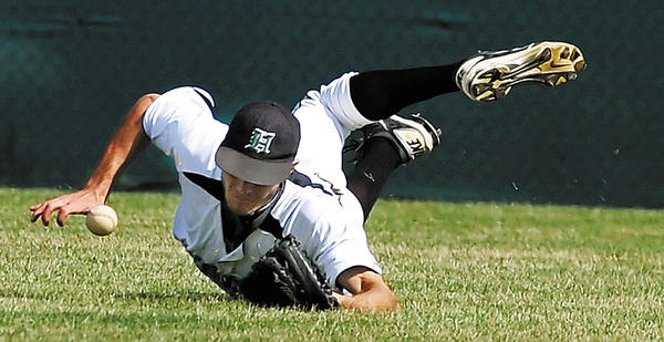 HCC center fielder Chris Kulik makes a diving attempt to catch the ball against Allegany in the third inning Tuesday.