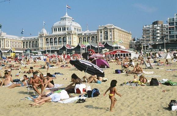 The Netherlands, Scheveningen, people relaxing on beach