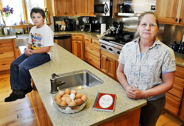 Kathy Kline, right, wrote a cookbook and dedicated it to her grandson Garron Long.