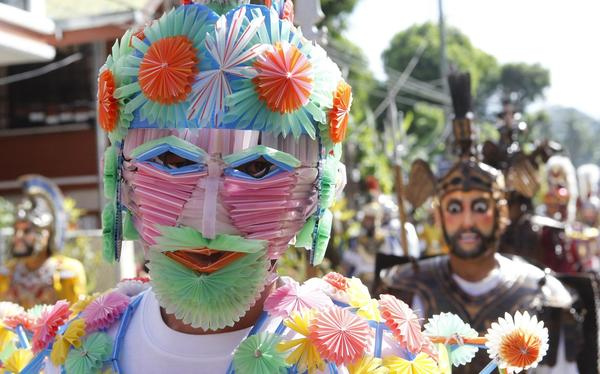 A penitent wearing a mask made of plastic straws joins others with costumes depicting Roman Centurions during a Lenten annual ritual in the town of Mogpog on Marinduque island, Phillipines.
