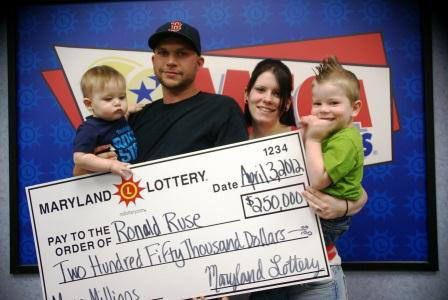 Ronald Ruse of Hagerstown and his family are pictured Monday at Maryland Lottery headquarters after he claimed a $250,000 prize in Friday night's Mega Millions drawing.