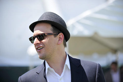 Actor Josh Charles shows off his hat in the infield at Pimlico Race Course before the 136th Preakness.