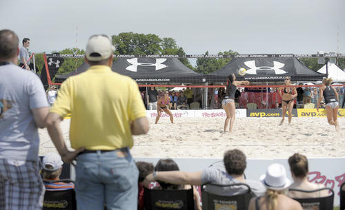 Fans watch a beach volleyball match in the Preakness infield at Pimlico Race Course.