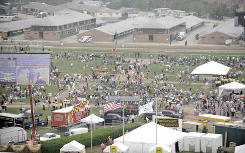 A view from the rooftop of the grandstand at Pimlico Race Course shows the sparse crowd gathered in the infield during the early afternoon before the 134th Preakness.
