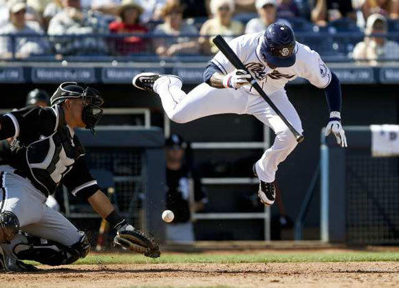 Orlando Hudson evades a ball while batting for the Padres in spring training this year.