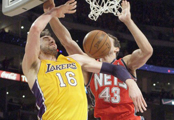 Lakers center Pau Gasol scores over New Jersey's Kris Humphries during the first half of the Lakers' 91-87 victory Tuesday at Staples Center.