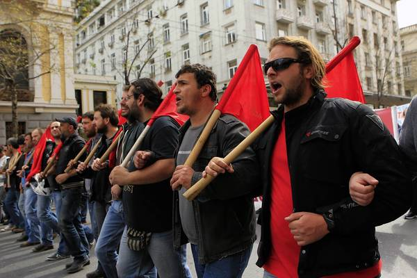 Communists and other workers march today through Athens protesting lack of payment for work.