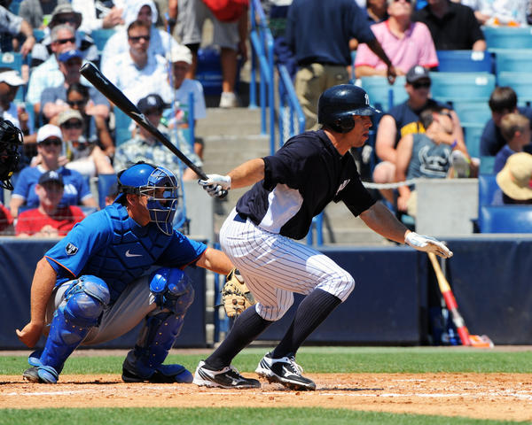 Yankees outfielder Brett Gardner puts the ball in play in a exhibition game vs. the Mets on Wednesday.