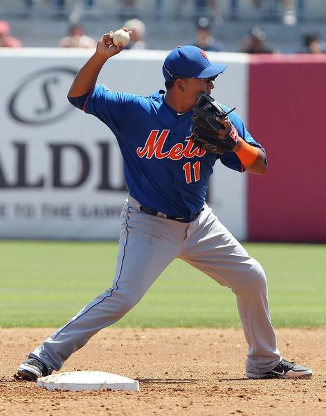 Mets shortstop Ruben Tejada throws onto first base to complete a third-inning double play vs. the Yankees on Wednesday.