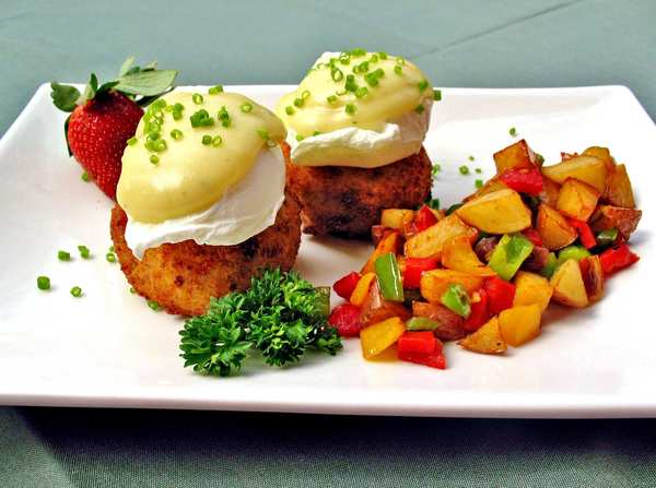 At the historic City Tavern restaurant in Philadelphia,  chef Walter Staib prepares his eggs Chesapeake using poached eggs and crab cakes with a house-made tarragon béarnaise sauce and potatoes O'Brien.